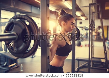 Fitness vrouw barbell gymnasium blond sterke vrouw Stockfoto © chesterf