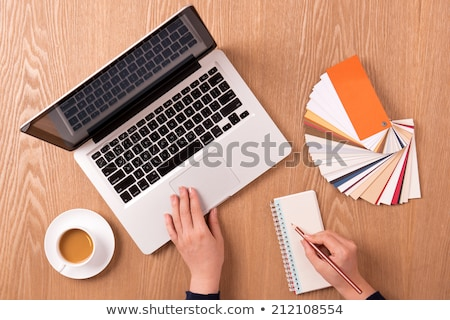 Stock photo: Laptop with blank notepad and pencil with set of color samples on old wooden table