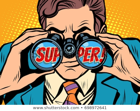 super businessman looking through binoculars stock photo © studiostoks