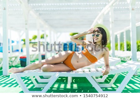 Seducente modello bikini posa piscina Foto d'archivio © dash