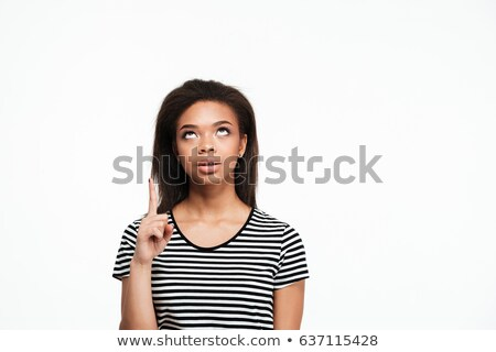 thinking young african lady pointing and looking aside stock photo © deandrobot