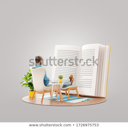 Young man sitting relaxed and reading Stock photo © IS2