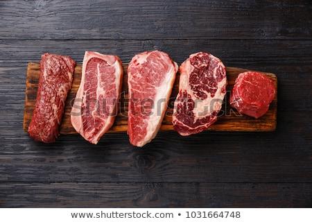 crudo · carne · negro · superior · vista - foto stock © yelenayemchuk