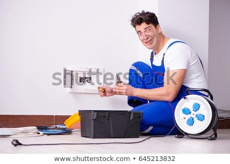 funny man doing electrical repair stock photo © elnur