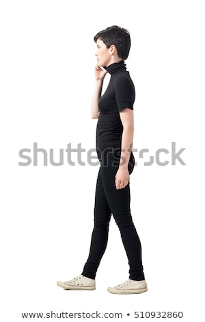 young woman in short pants looks to side  Stock photo © feedough