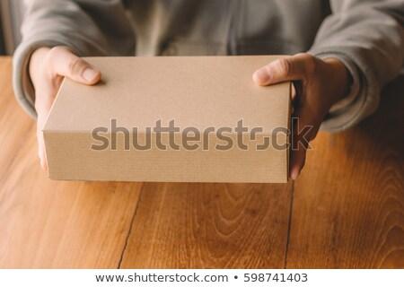 Man holding cardboard box package for mock up design Stock photo © stevanovicigor
