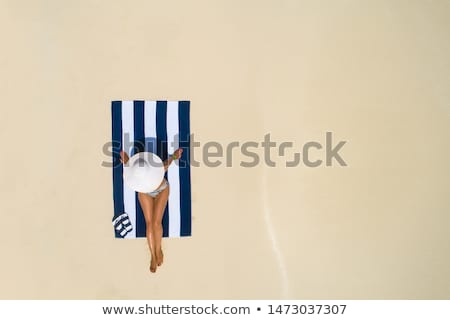 A girl relaxing on a beach towel Stock photo © IS2
