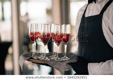 Kéz tálca szemüveg rózsaszín pezsgő rózsaszín rózsa Stock fotó © DenisMArt