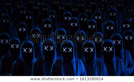 Group of hooded computer hackers with obscured faces Stock photo © stevanovicigor