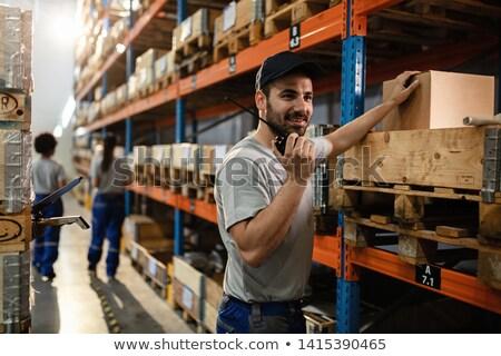 Worker using walkie talkie in warehouse Stock photo © IS2
