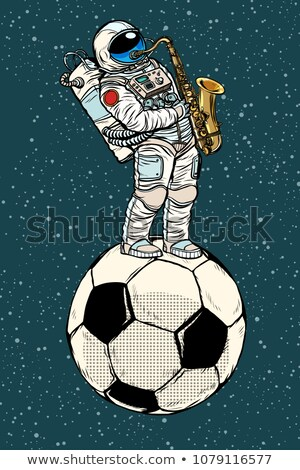 Astronaut plays saxophone on a football soccer ball Stock photo © studiostoks