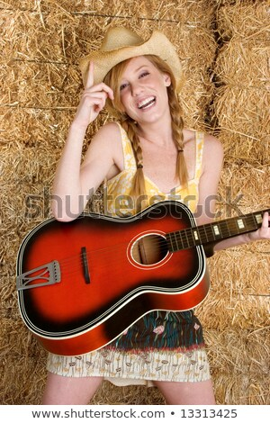 Woman with freckles and red hair playing acoustic guitar Stock photo © sumners