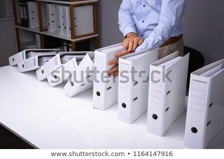 Férfi tömés zuhan akták asztal iroda Stock fotó © AndreyPopov