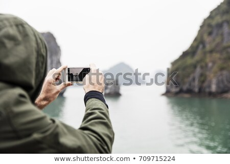 Man photographed from the boat in Ha Long Bay in Vietnam Stock photo © boggy