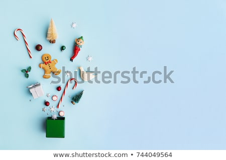 christmas gift box candy canes and gingerbread man stock photo © karandaev