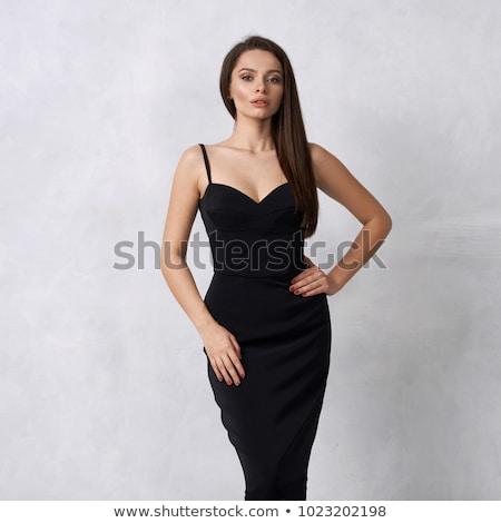 Morena preto vestir posando sofá menina Foto stock © acidgrey