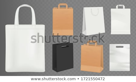 Realistic brown Paper shopping bag with handles isolated on white background. Vector illustration Stock photo © olehsvetiukha