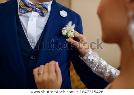 Stockfoto: Bride Correcting Boutonniere On Grooms Jacket