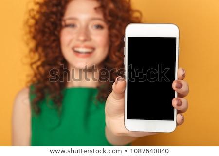 счастливым женщину отображения телефон изолированный Сток-фото © deandrobot
