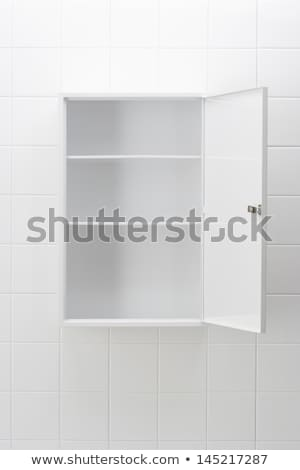Opened cabinet on white Stock photo © magraphics