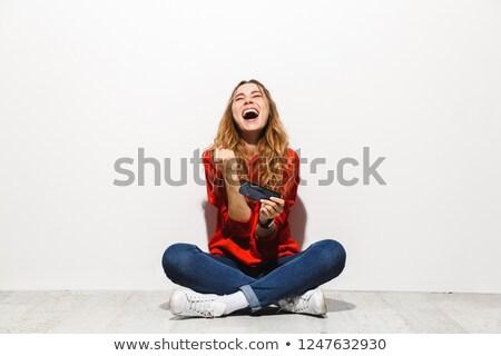 Foto ottimista donna 20s sorridere giocare Foto d'archivio © deandrobot