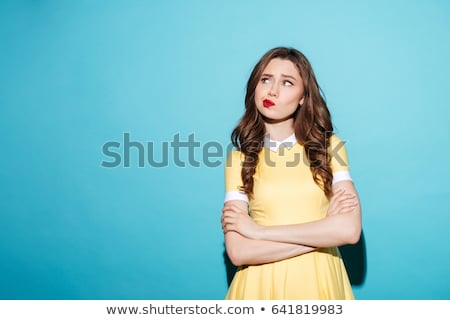 Portrait of a mad young woman standing Stock photo © deandrobot