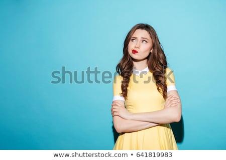 elégedetlen · megrémült · fiatal · nő · áll · izolált · fotó - stock fotó © deandrobot