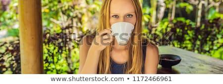 young woman drinks coffee luwak in the gazebo banner long format stock photo © galitskaya