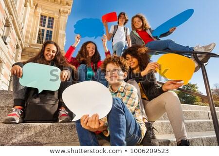 A street boy with speech balloon Stock photo © colematt