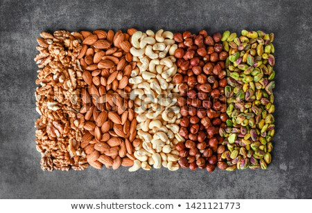 various nuts selection on stone table stockfoto © karandaev