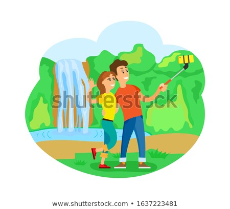 Travelers Couple at Waterfall Taking Selfie, Trip Foto stock © robuart