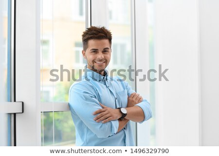 бизнесмен окна служба Постоянный глядя из Сток-фото © artfotodima