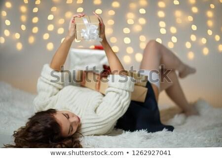 Kız lies kabarık battaniye Noel hediye Stok fotoğraf © ElenaBatkova