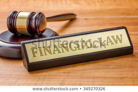 a gavel and a name plate with the engraving financial law stock photo © zerbor