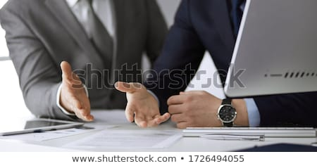teamwork concept business executives discussing document work a stock photo © snowing
