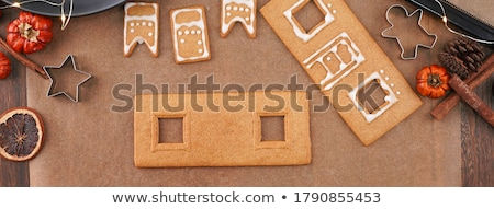 close up of woman making gingerbread houses stock photo © dolgachov
