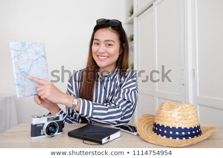 women with map travelling and recording video blog Stock photo © dolgachov
