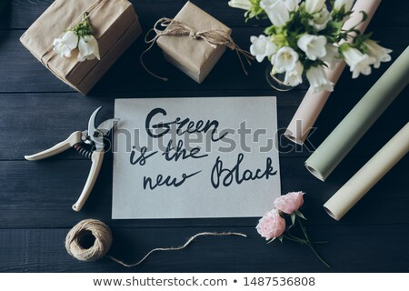 Above view of gift shop workplace with gifts packaged into kraft paper Stock photo © pressmaster