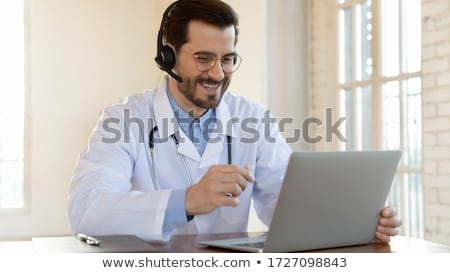 doctor with laptop and male patient at hospital Stock photo © dolgachov