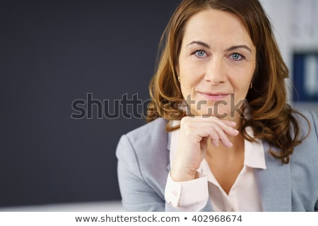 Close-up of confident business person resting chin on hand and l Stock photo © lichtmeister