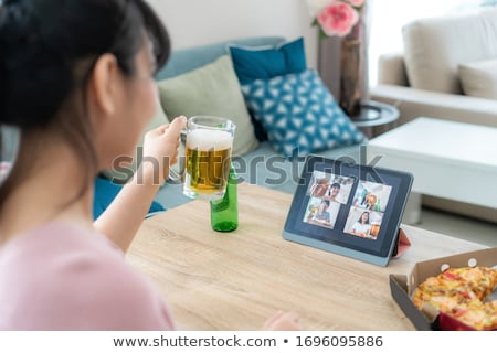 friends with tablet computer drinking beer at home Stock photo © dolgachov