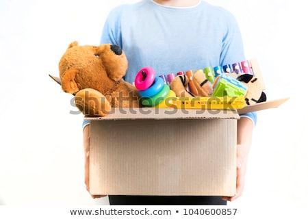 Cardboard box full of toys on white background Stock photo © bluering