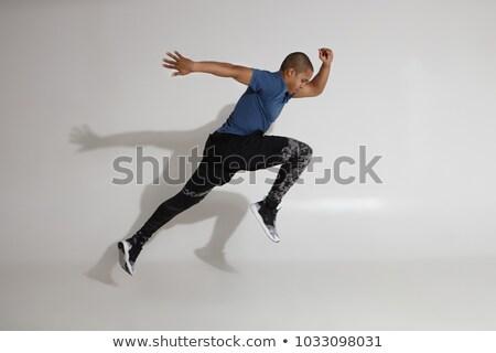 Coup homme sautant mouvement heureux souriant Photo stock © benzoix