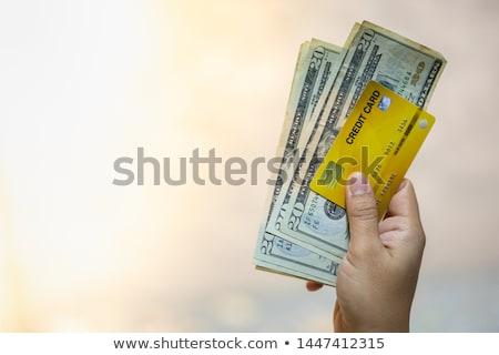 close up of woman hands holding us dollar money Stock photo © dolgachov