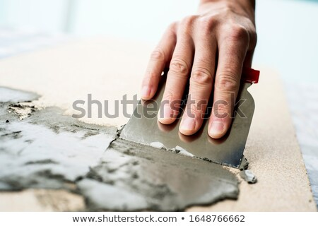 man spreading some concrete on a surface Stock photo © nito
