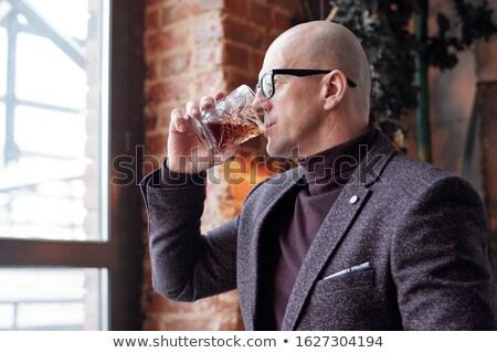 лысые человека дегустация виски вид сбоку задумчивый Сток-фото © pressmaster