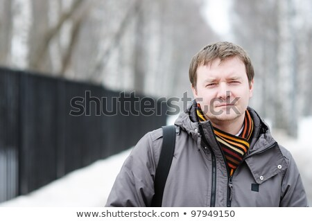 Portrait of unshaven thoughtful middle aged male with pensive expression looks upwards, wears stylis Stock photo © vkstudio