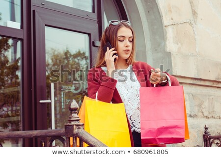 Businesswoman being late to her meeting checking the time Stock photo © Kzenon