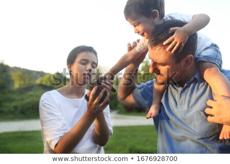 Young family with little son and kitten in park Stock photo © dashapetrenko