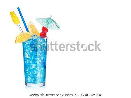 Blue lagoon cocktail highball glass with straw,stirrer and orange slice with sweet cherry and umbrel Stock photo © DenisMArt